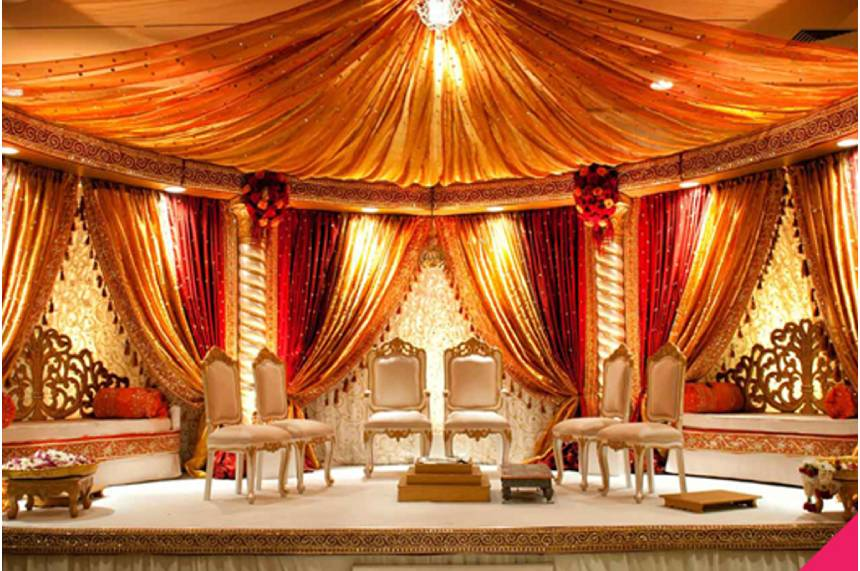 The Colorful Stage Decoration with Bright Shade of Decoration For Bride and Groom